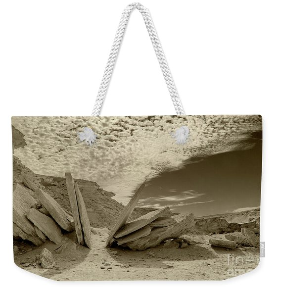 Weekender Tote Bag featuring the photograph When God Cuts Slices..... by Arik Baltinester
