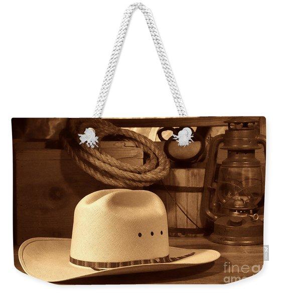 White Cowboy Hat On Workbench Weekender Tote Bag