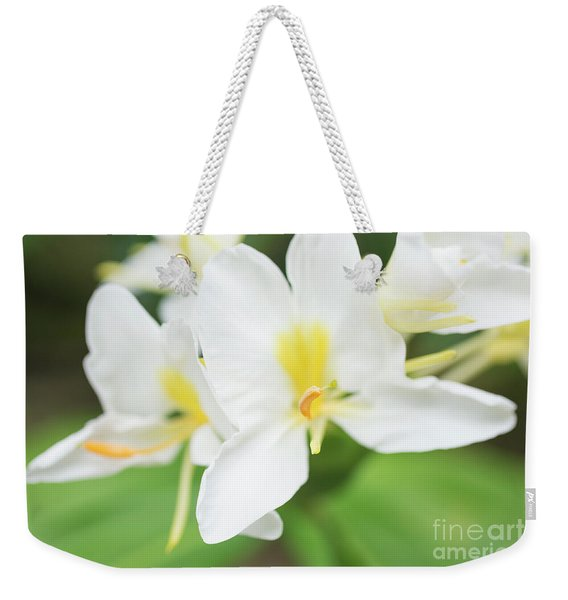 Weekender Tote Bag featuring the photograph White Ginger Blossom by Charmian Vistaunet