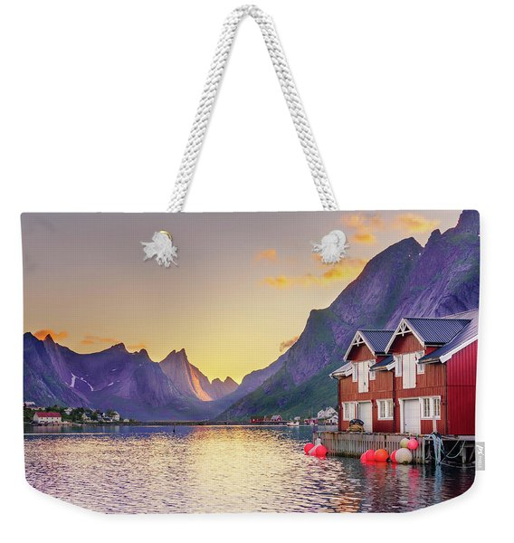 Weekender Tote Bag featuring the photograph White Night In Reine by Dmytro Korol