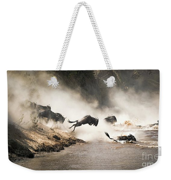 Wildebeest Leap Of Faith Into The Mara River Weekender Tote Bag