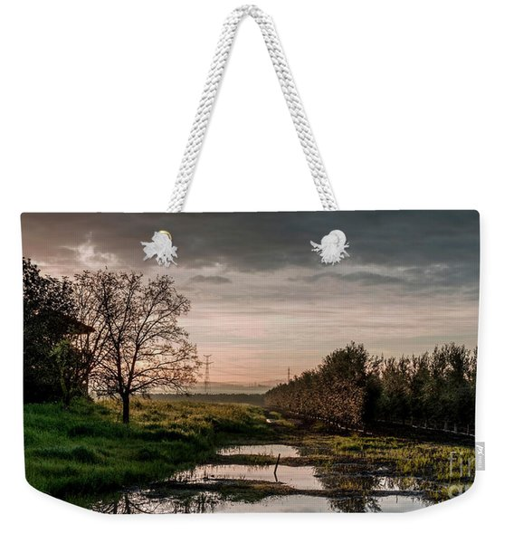 Weekender Tote Bag featuring the photograph Winter Sunrise by Arik Baltinester