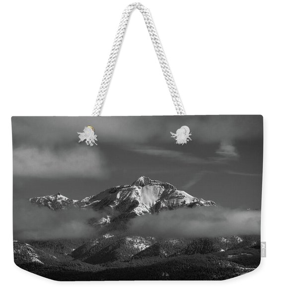 Weekender Tote Bag featuring the photograph Winter's Window by Jason Coward