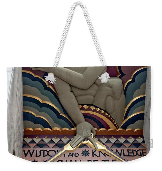 Weekender Tote Bag featuring the photograph Wisdom Lords Over Rockefeller Center by Lorraine Devon Wilke
