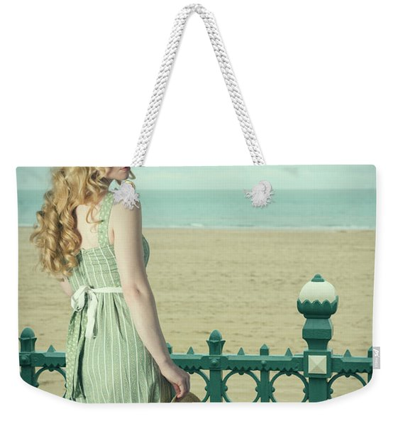 Woman By Railings At The Beach Weekender Tote Bag