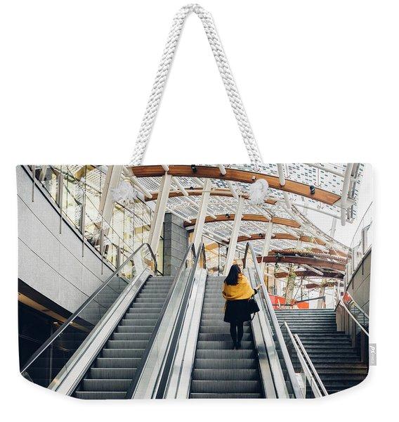 Woman Going Up Escalator In Milan, Italy Weekender Tote Bag