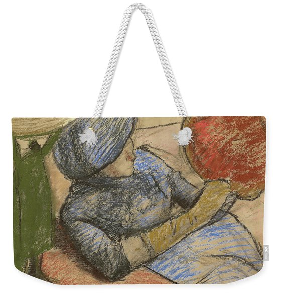 Woman Holding A Hat In Her Hand Weekender Tote Bag