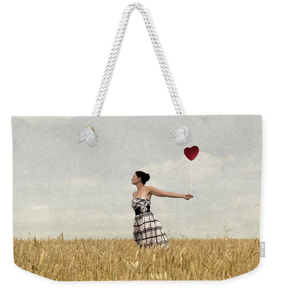Weekender Tote Bag featuring the photograph Woman In Corn Field With Heart Shaped Balloon by Clayton Bastiani