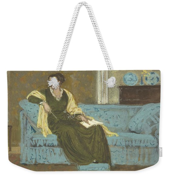 Woman Seated On A Sofa Weekender Tote Bag