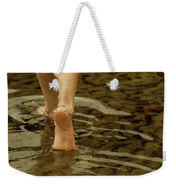 Weekender Tote Bag featuring the photograph Woman Walking Through Water by Clayton Bastiani