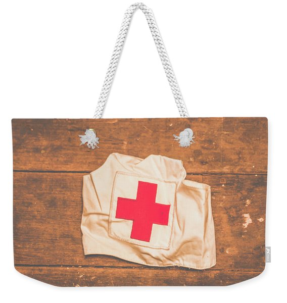 Ww2 Nurse Cap Lying On Wooden Floor Weekender Tote Bag