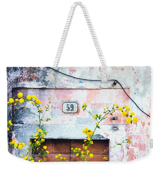Yellow Flowers And Decayed Wall Weekender Tote Bag