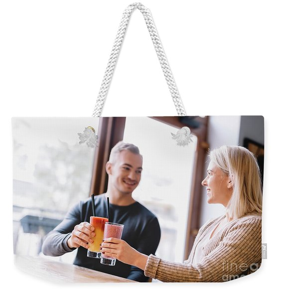 Young Couple With A Drink Spending Time Together. Weekender Tote Bag