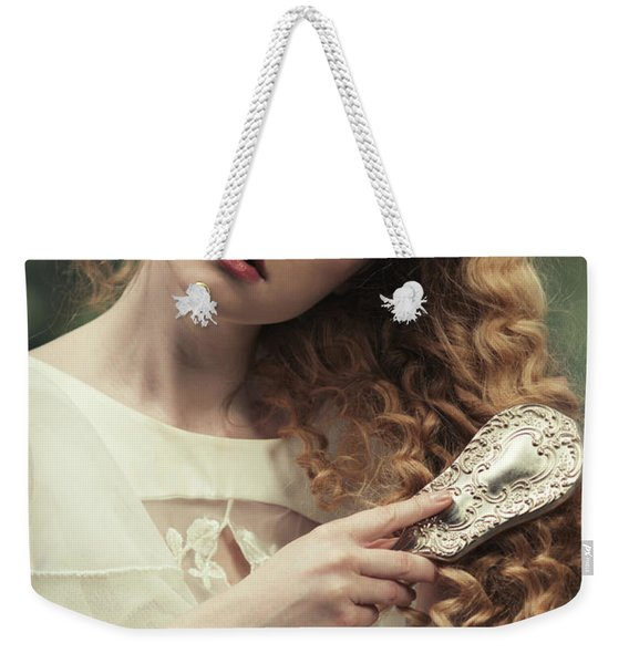 Young Woman Brushing Her Hair Weekender Tote Bag