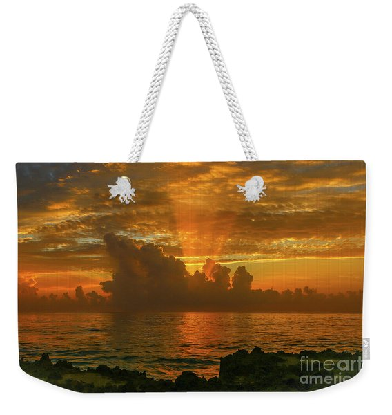 Weekender Tote Bag featuring the photograph Orange Sun Rays by Tom Claud