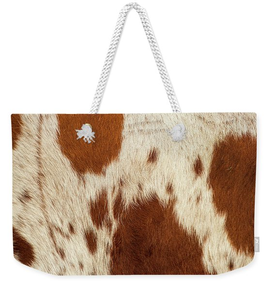 Weekender Tote Bag featuring the photograph Pattern Of A Longhorn Bull Cowhide. by Rob D Imagery