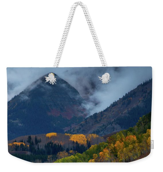 Weekender Tote Bag featuring the photograph Stormy Weather Over The Elks by John De Bord
