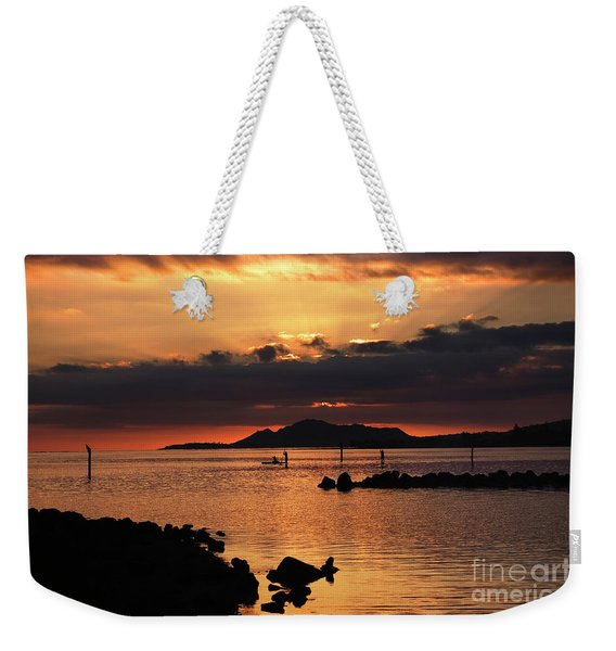Weekender Tote Bag featuring the photograph Sunset Over Maunalua Bay by Charmian Vistaunet