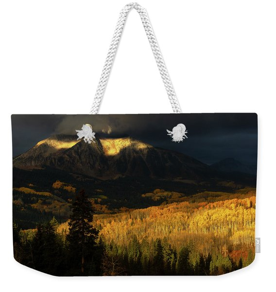 Weekender Tote Bag featuring the photograph The Golden Light by John De Bord