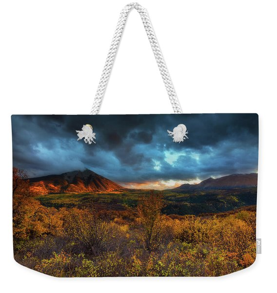 Weekender Tote Bag featuring the photograph The Last Light by John De Bord