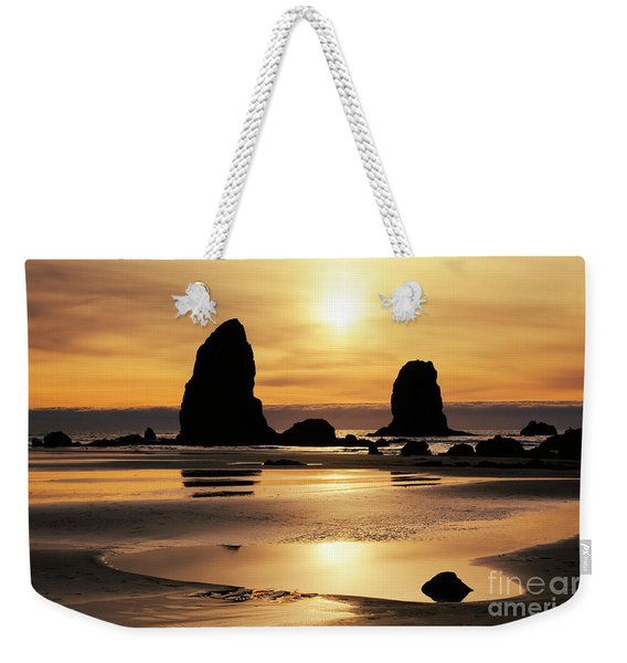 Weekender Tote Bag featuring the photograph Cannon Beach Sunset by Charmian Vistaunet