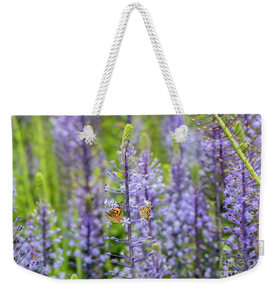 Weekender Tote Bag featuring the photograph The Couple by Arik Baltinester