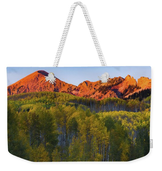 Weekender Tote Bag featuring the photograph A Colorado Glow by John De Bord