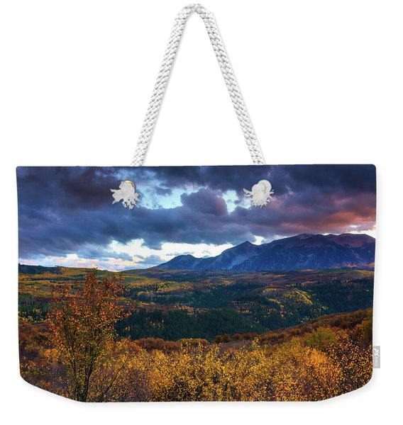Weekender Tote Bag featuring the photograph A Fall Sunset In Colorado by John De Bord