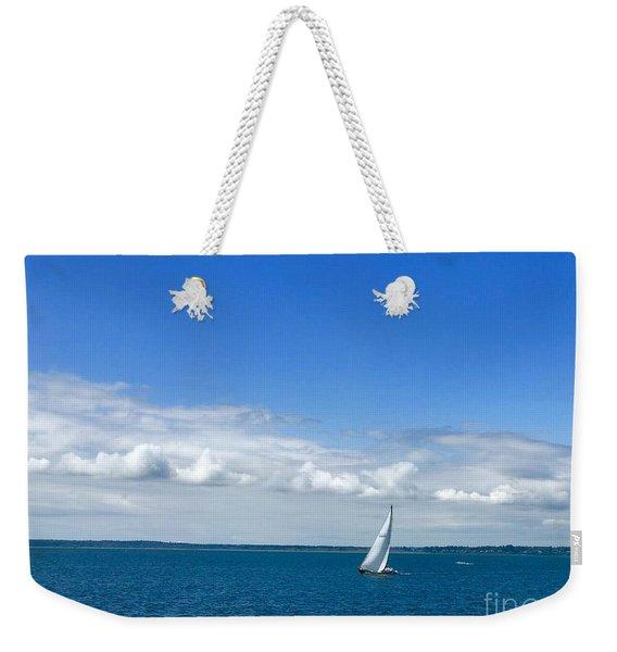 A Single Sailboat In Blue Weekender Tote Bag