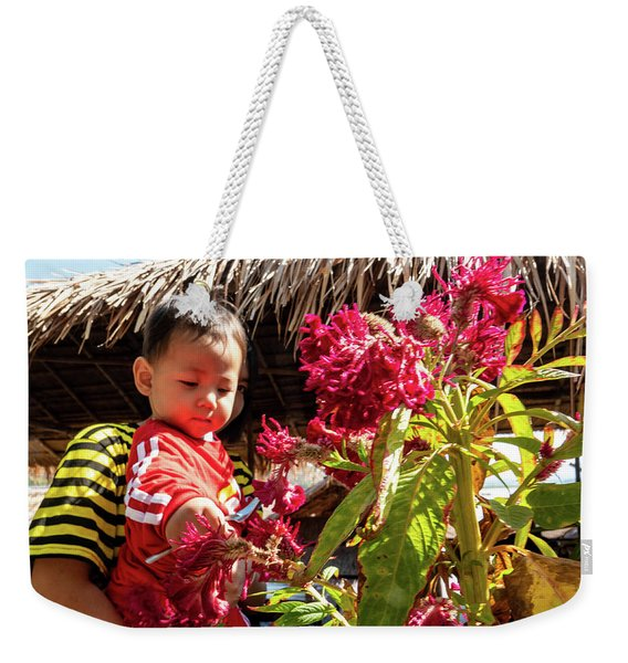 A Small Person With Reflected Flowers Weekender Tote Bag