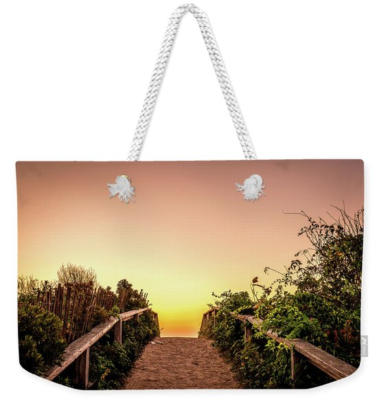 Weekender Tote Bag featuring the photograph Path Over The Dunes At Sunrise. by Jeff Sinon
