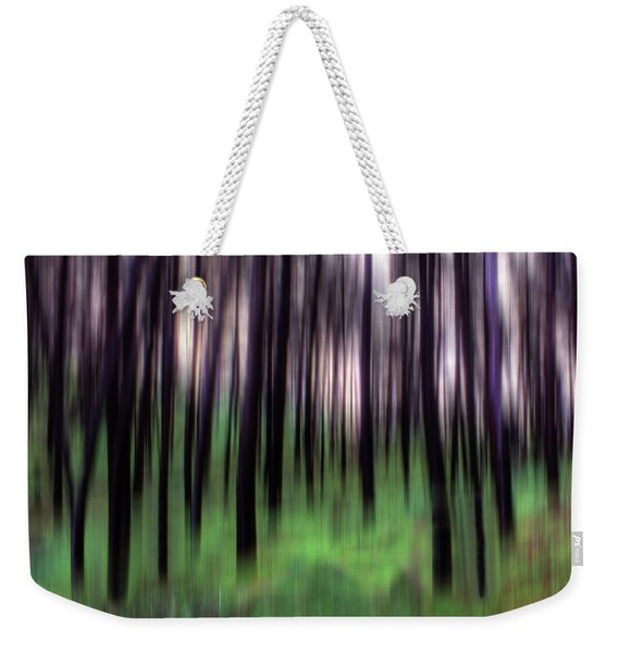 Weekender Tote Bag featuring the photograph Black Pines In A Green Wood by Wayne King