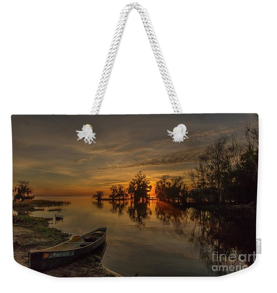 Weekender Tote Bag featuring the photograph Blue Cypress Canoe by Tom Claud