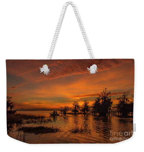 Weekender Tote Bag featuring the photograph Blue Cypress Sunrise With Boat by Tom Claud