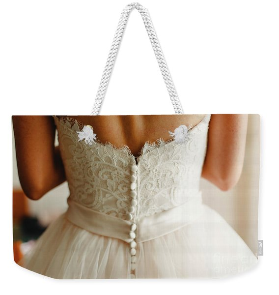 Bride Getting Ready, They Help Her By Buttoning The Buttons On The Back Of Her Dress. Weekender Tote Bag