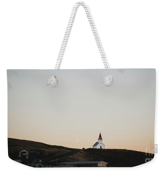 Church On Top Of A Hill And Under A Mountain, With The Moon In The Background. Weekender Tote Bag