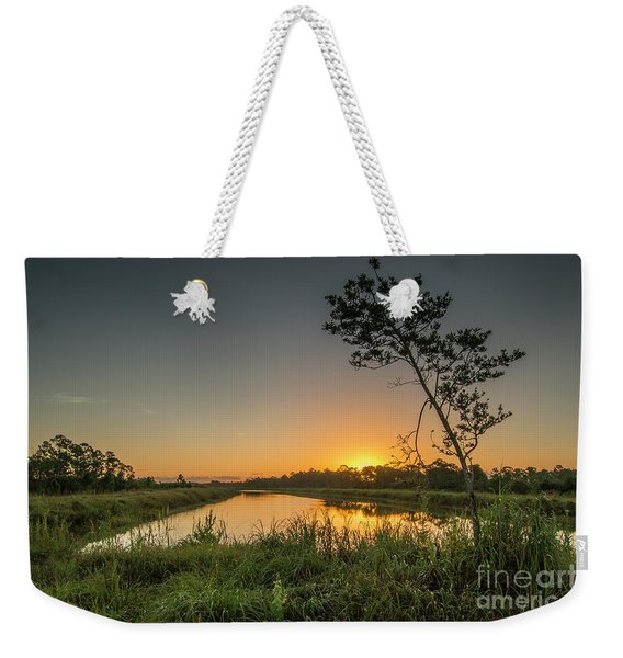 Weekender Tote Bag featuring the photograph Cloudless Hungryland Sunrise by Tom Claud