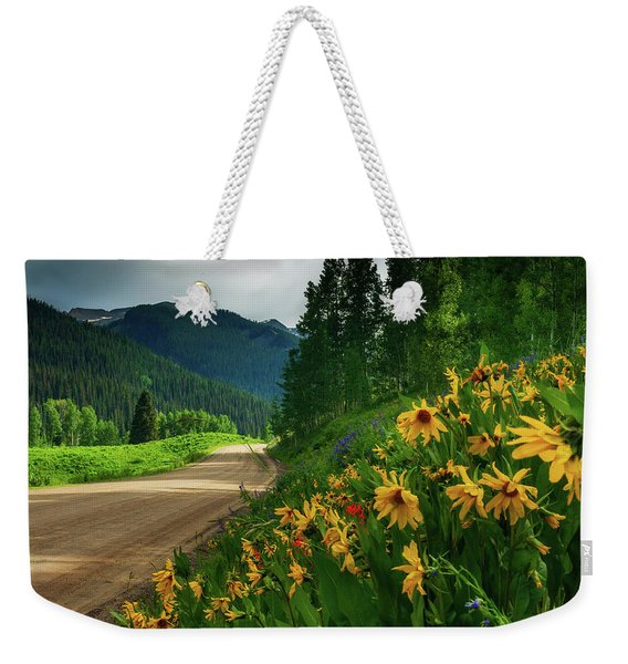 Weekender Tote Bag featuring the photograph Colorado Wildflowers by John De Bord