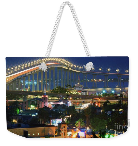 Weekender Tote Bag featuring the photograph Coronado Bay Bridge Shines Brightly As An Iconic San Diego Landmark by Sam Antonio Photography