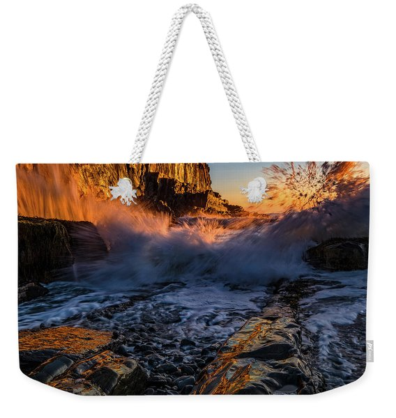 Weekender Tote Bag featuring the photograph Crash by Jeff Sinon