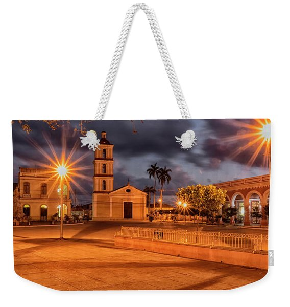 Weekender Tote Bag featuring the photograph Cuban Dawn by Tom Singleton