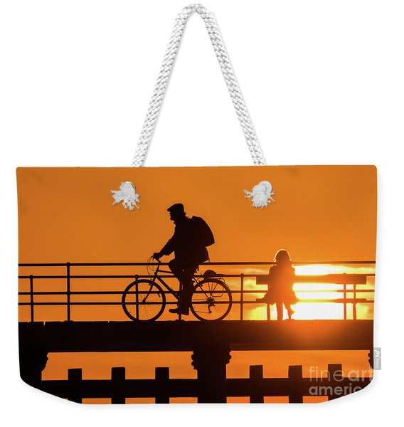Cyclist Silhouetted At Sunset Weekender Tote Bag