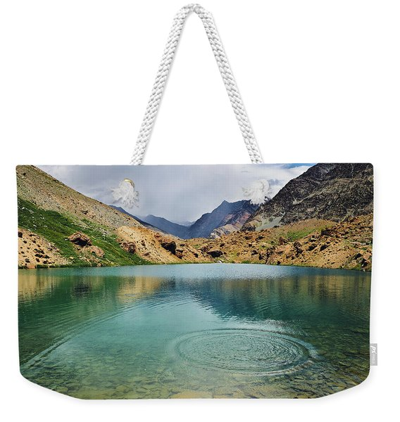 Weekender Tote Bag featuring the photograph Distant Rains by Whitney Goodey