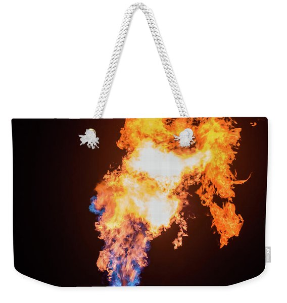 Weekender Tote Bag featuring the photograph Dragon Breath by Dheeraj Mutha