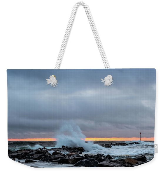 Weekender Tote Bag featuring the photograph Dramatic Beginnings. by Jeff Sinon