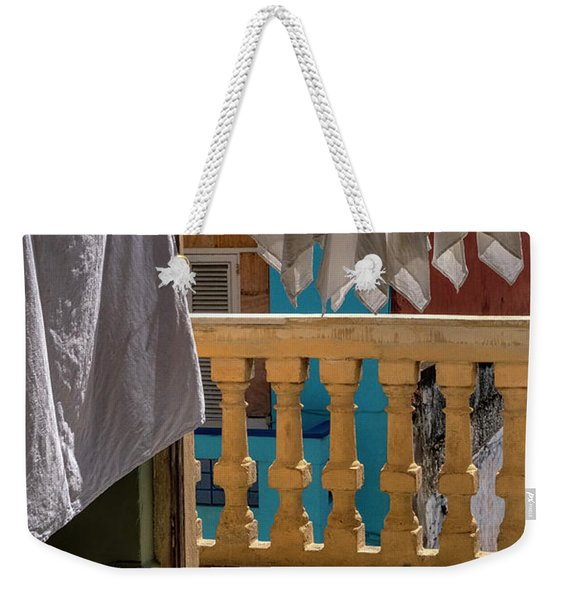 Weekender Tote Bag featuring the photograph Drying Napkins by Tom Singleton