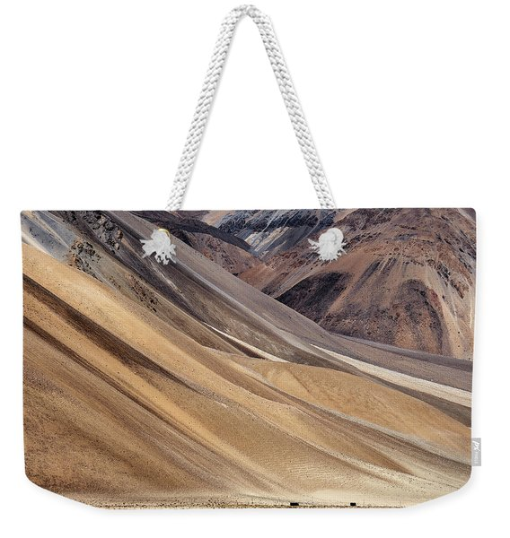 Weekender Tote Bag featuring the photograph Dwarfed by Whitney Goodey