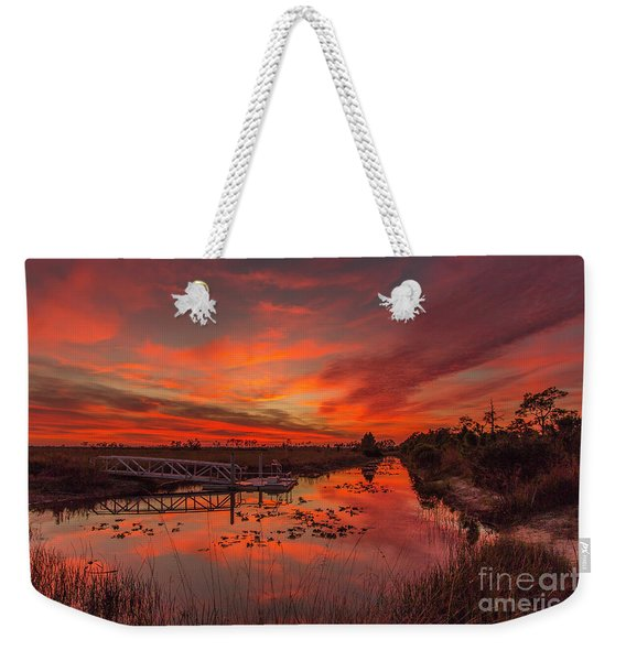 Weekender Tote Bag featuring the photograph Explosive Sunset At Pine Glades by Tom Claud