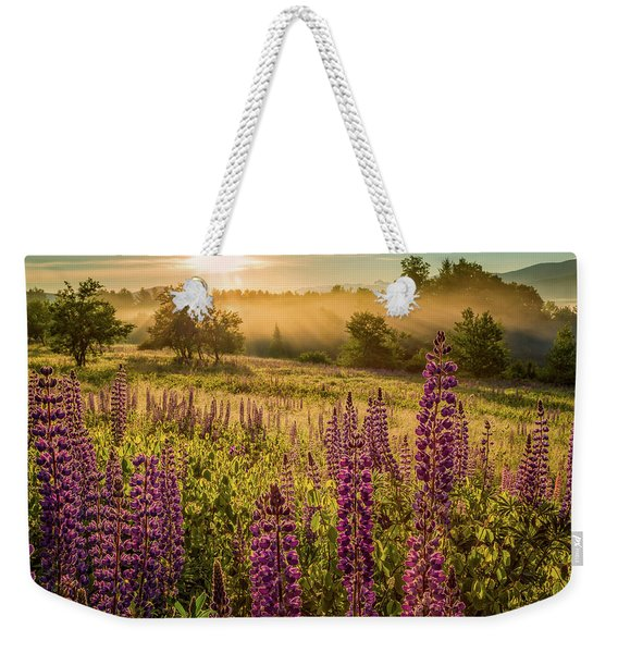 Weekender Tote Bag featuring the photograph Fields Of Lupine by Jeff Sinon