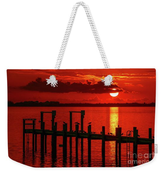 Weekender Tote Bag featuring the photograph Fireball And Pier Sunrise by Tom Claud